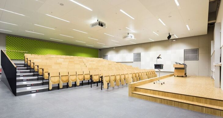 Row of seats and tables in a new lecture hall